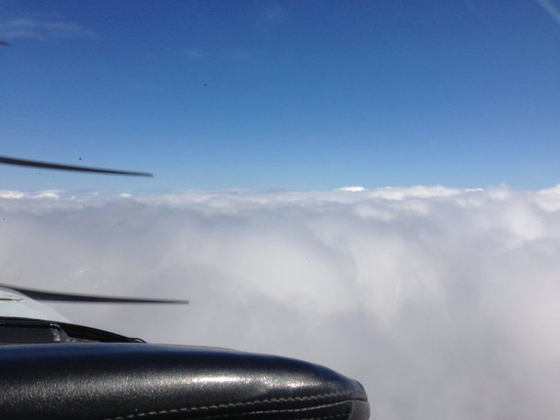 Flying over clouds at 9,700""