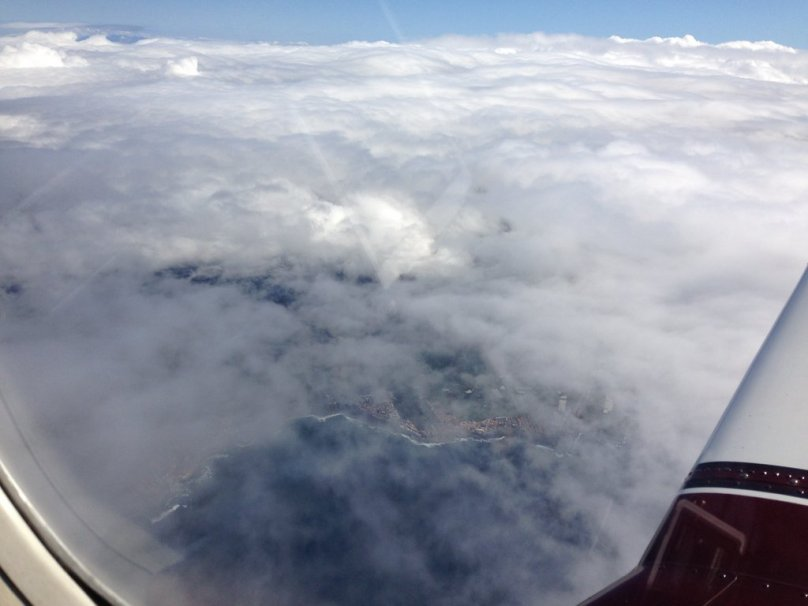 The north coast of Tenerife can be seen through the clouds