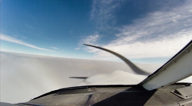 Above the sea of clouds cockpit view